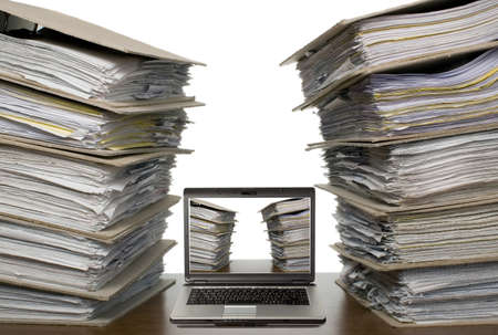 catalogs: There is laptop near a lot of documents and catalogs