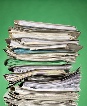 There are documents and papers on green background Stock Photo