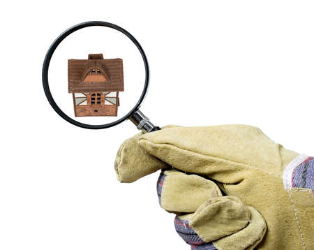 Man with industrial glove is holding magnifying glass photo