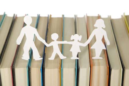 Family figures made from paper with books background, school theme photo