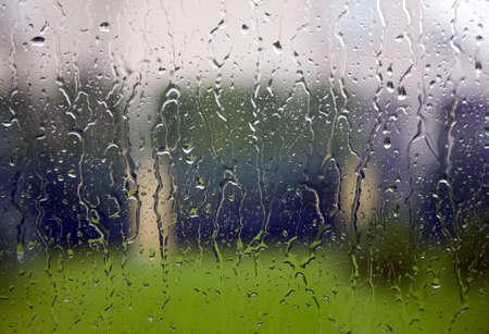 View through the window to garden of house, raining photo