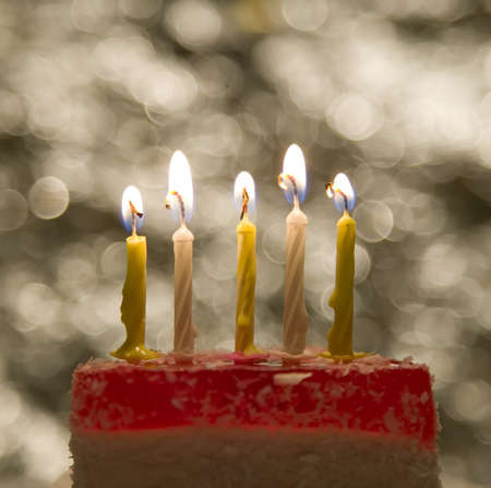 Cake with candle and flame on celebration theme background photo
