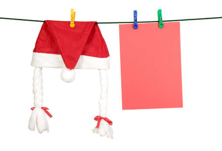 paper hanger: Christmas cap and sheet of paper are hanging on hanger