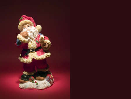 A figure of santa claus on red background photo