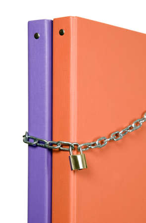 catalogs: Two catalogs of documents are locked with chain Stock Photo