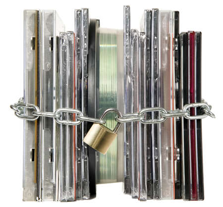 Compact discs are secured with metal chain and lock Stock Photo - 8548996