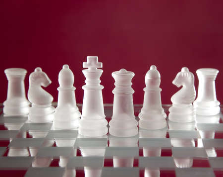 Game for leisure chess with figures on red background photo