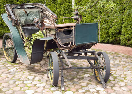 Old antique green carriage with metal wheels with nature background Stock Photo - 9832395