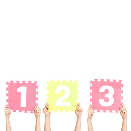 Children are holding numbers one two three in their hands photo