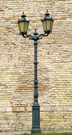 streetlight: Metal old style lamp with grunge brick background