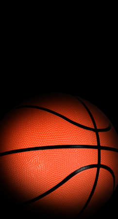 basketball ball: Basketball ball with dark edges on black background, sport concept