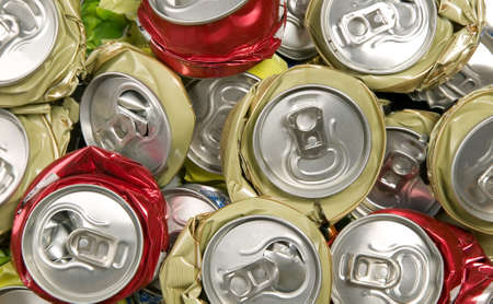 crushed aluminum cans: Background made from smashed cans, pollution and recycling concept