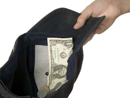 poorness: Dollars placed on cap which is held by man, poorness concept