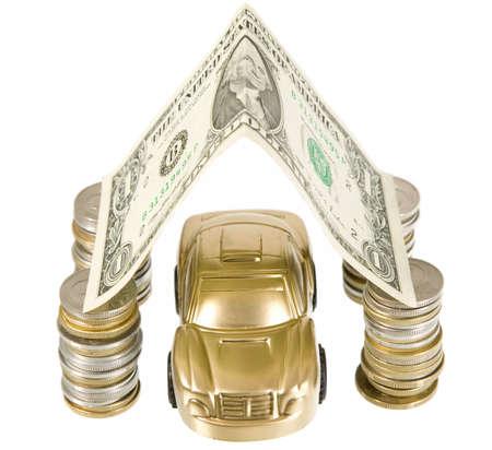 A golden car under coins ant banknotes garage photo