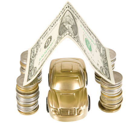 A golden car under coins ant banknotes garage photo