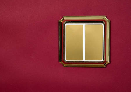 A golden socket on a red background  photo