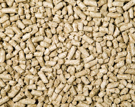 There are many shredded brown wood pellets photo