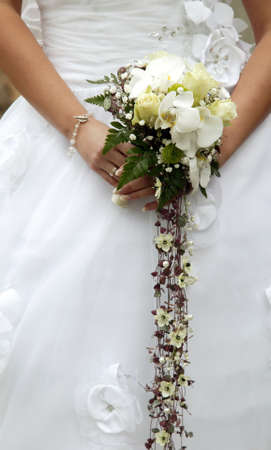There is the beautiful white bride bouquet photo