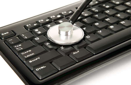 A medicine stethoscope is lying on black keyboard Stock Photo - 17859561
