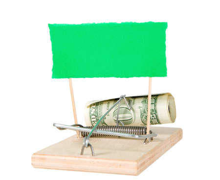 A mouse trap with money and paper on it photo