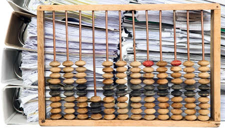 Old mathematical calculator abacus with bunch of papers photo
