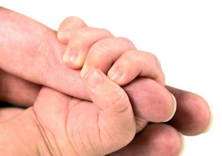 Baby boy is holding his mothers hand, white background photo