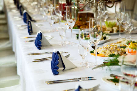 banquet table: Wedding table with forks, wine glasses, knifes and food Stock Photo
