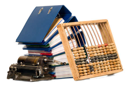 Vintage calculator and abacus placed near bunch of papers, documents photo