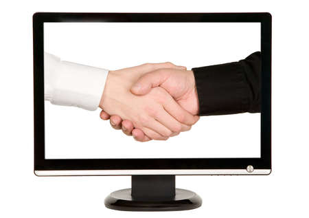 shakes hands: Man shakes hands with businessman on lcd monitor