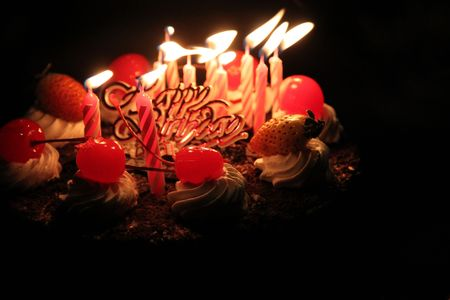 'dark ages': Birthday cake with lighting candles Stock Photo