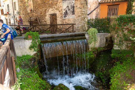 Streams that form small waterfalls in the center of the town of rasiglia Stock Photo