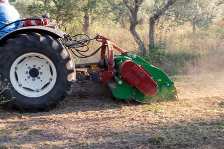 shredding with tractor and stalk chopper