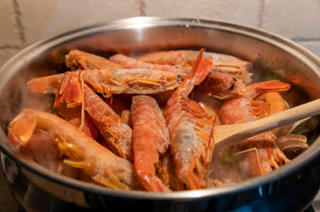 tomato fish soup with seafood, clams, Argentine prawns