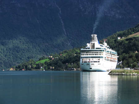 fiord: Big, luxurious passenger ferry in a Norwegian fjord.