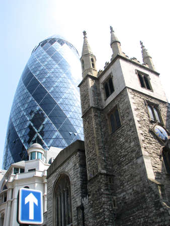 Gherkin building and church of St. Andrew Undersha, London Stock Photo - 9455109