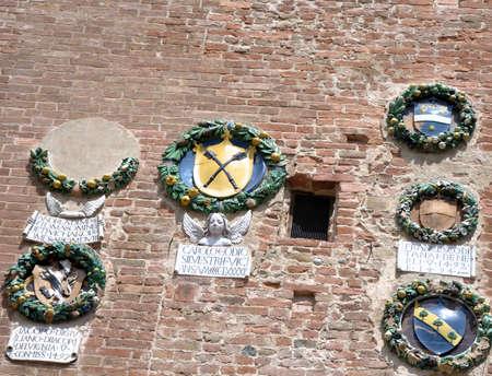 brich: Town Hall details in Certaldo Alto, Tuscany, Italy