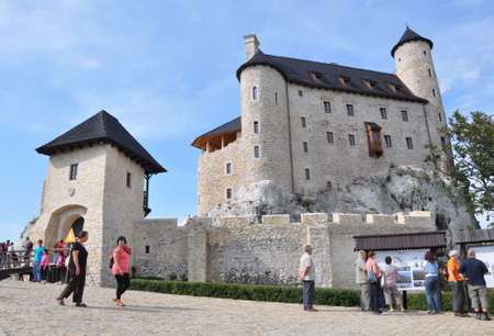 eagle nest rock: Bobolice, Poland, September 19, 2011 - People admiring renovated castle of Bobolice