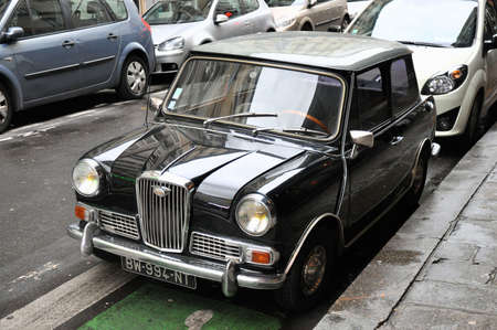 metalized: Paris, France - 23rd of January 2013  Black authentic Wolseley Hornet MK III parked on a steet of Paris Editorial