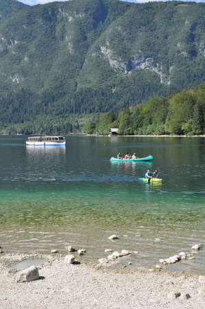 bohinj: Bohinj, Slovenia - 25th of July 2012: Goup of tourists kayaking on the Bohinj Lake in Julian Alps. Editorial
