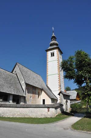 bohinj: The church Sveti Janez on Lake Bohinj in the Julian Alps,Slovenia Stock Photo