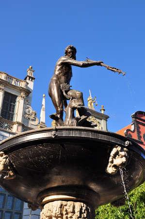 nas:  Famous Neptune fountain at Dlugi Targ square in Gdansk  also known nas Danzig  in Pomerania region, Poland