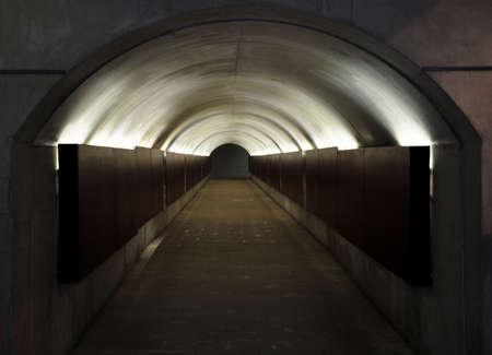 oncept: Underground passage with neon lights.