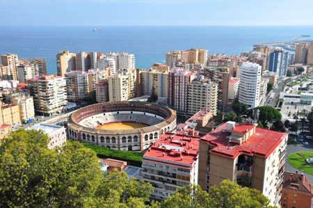 toros: View of Malaga, Spain with the Plaza de Toros (bullring) in the foreground.