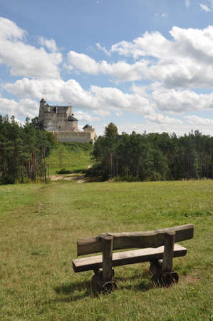bobolice: View of Bobolice castle seen from the distance, bench for tourists on the first plan