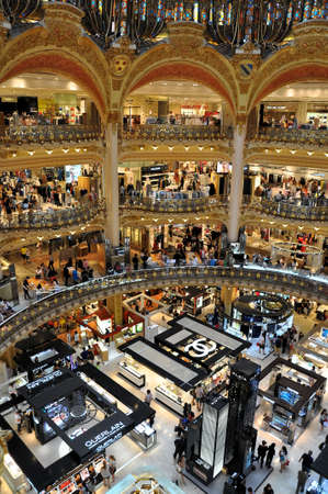 lafayette: PARIS, FRANCE - JULY 2: Inside part of the famous Galeries Lafayette with its brand stands stalls such as Chanel and Guerlain on July 2, 2015 in Paris, France. The Galeries Lafayette is the most famous luxury store in Paris. Editorial