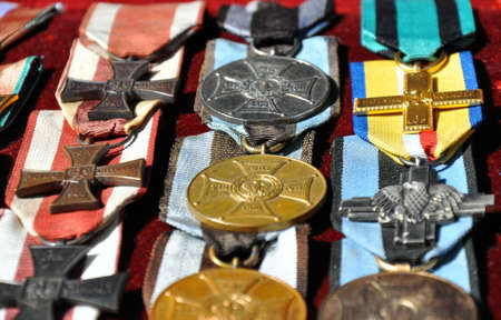 war decoration: GRUDZIADZ, POLAND - JUNE 18 : Closeup of variety of orders War Order of Virtuti Militari on street market on June 18, 2015 in Grudziadz, Poland. Order is Polands highest military decoration for heroism and courage in the face of the enemy at war.