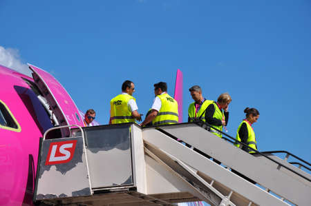 KATOWICE - JULY 2: Cabin crew staff leaving the Wizzair Airbus A320 after the landing on July 2, 2015 in Katowice Airport, Poland. Wizzair is one of the largest low-cost airlines. Editorial