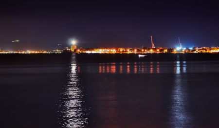 Messina harbor and lighthouse at night Stock Photo
