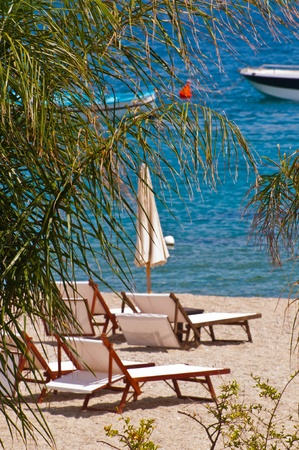 sunbeds and umbrellas on the white beach