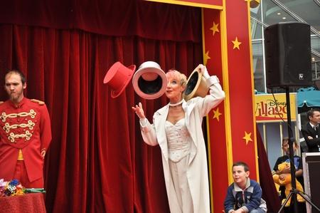 disneyland paris, august, 13, 2010 - disney village,  little circus, juggler with hats in disney village out of disneyland paris